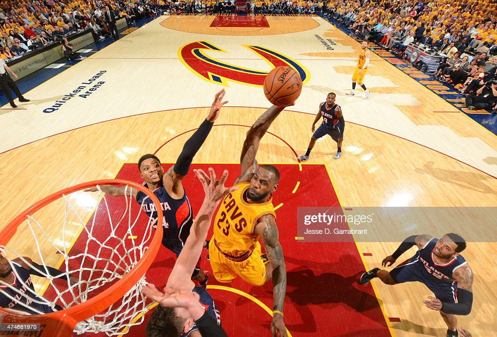 LeBron James of the Cleveland Cavaliers dunks in traffic against the Atlanta Hawks at the Quicken Loans Arena During Game Three of the Eastern...