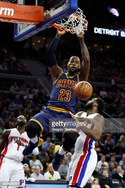 LeBron James of the Cleveland Cavaliers dunks next to Andre Drummond of the Detroit Pistons during the first half at the Palace of Auburn Hills on...