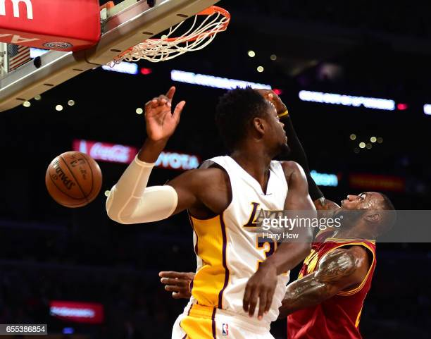 LeBron James of the Cleveland Cavaliers dunks over Julius Randle of the Los Angeles Lakers during the first half at Staples Center on March 19 2017...