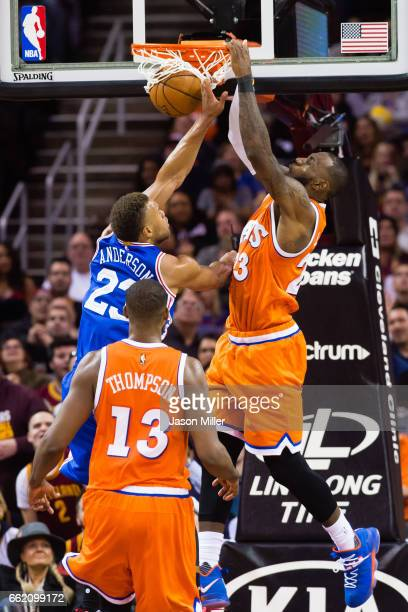 LeBron James of the Cleveland Cavaliers dunks over Justin Anderson of the Philadelphia 76ers during the first half at Quicken Loans Arena on March 31...