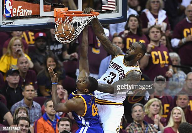 LeBron James of the Cleveland Cavaliers dunks the ball against Harrison Barnes of the Golden State Warriors during the second half in Game 4 of the...