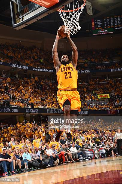 LeBron James of the Cleveland Cavaliers dunks the ball against the Atlanta Hawks at the Quicken Loans Arena During Game Three of the Eastern...
