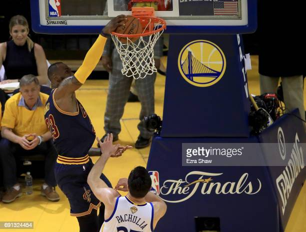 LeBron James of the Cleveland Cavaliers dunks the ball against the Golden State Warriors in Game 1 of the 2017 NBA Finals at ORACLE Arena on June 1...