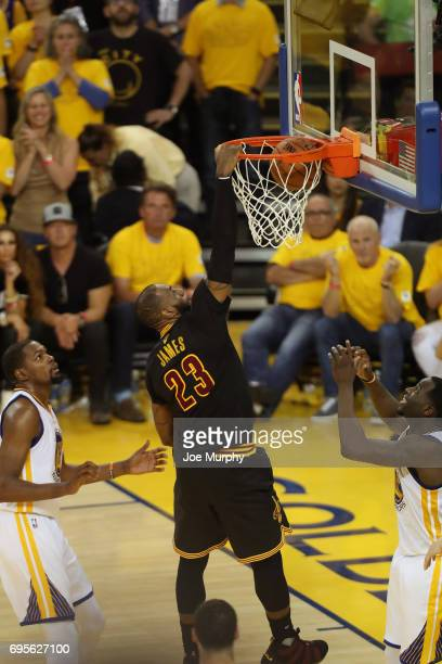 LeBron James of the Cleveland Cavaliers dunks the ball against the Golden State Warriors in Game Five of the 2017 NBA Finals on June 12 2017 at...
