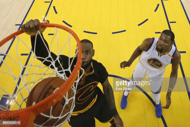 LeBron James of the Cleveland Cavaliers dunks the ball ahead of Kevin Durant of the Golden State Warriors in Game 5 of the 2017 NBA Finals at ORACLE...