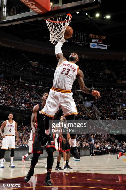 LeBron James of the Cleveland Cavaliers dunks the ball during a game against the Miami Heat on March 6 2017 at Quicken Loans Arena in Cleveland Ohio...