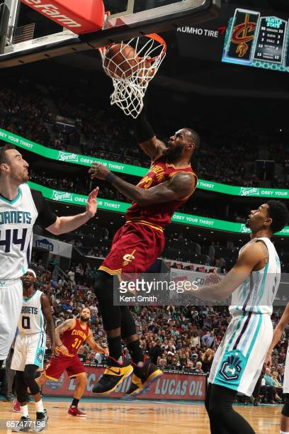 LeBron James of the Cleveland Cavaliers dunks the ball during a game against the Charlotte Hornets on March 24 2017 at the Spectrum Center in...