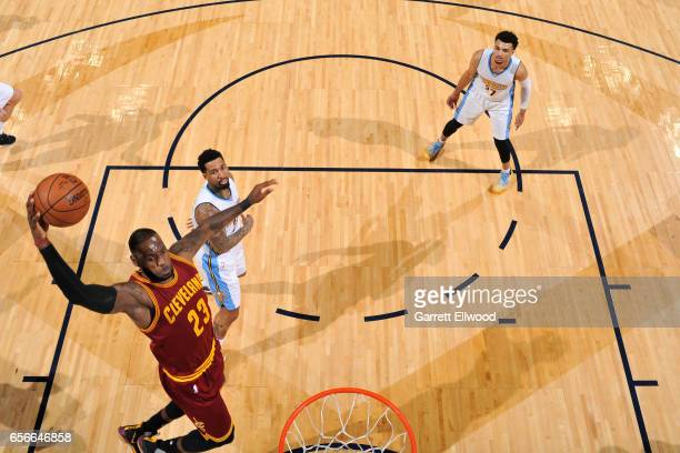 LeBron James of the Cleveland Cavaliers dunks the ball during the game against the Denver Nuggets on March 22 2017 at the Pepsi Center in Denver...