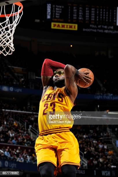 LeBron James of the Cleveland Cavaliers dunks the ball during the game against the Washington Wizards on March 25 2017 at Quicken Loans Arena in...