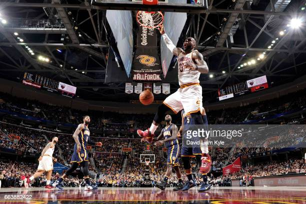 LeBron James of the Cleveland Cavaliers dunks the ball during the game against the Indiana Pacers on April 2 2017 at Quicken Loans Arena in Cleveland...