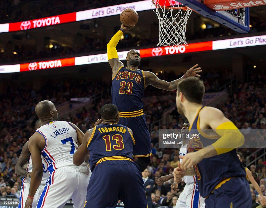 LeBron James #23 of the Cleveland Cavaliers dunks the ball past Carl Landry #7 of the Philadelphia 76ers on January 10, 2016 at the Wells Fargo Center in Philadelphia, Pennsylvania.