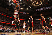 LeBron James of the Cleveland Cavaliers dunks the ball surrounded by Chris Bosh Hedo Turkoglu and Andrea Bargnani of the Toronto Raptors on January...