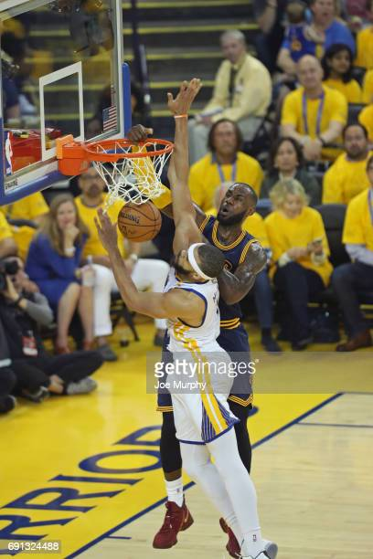 LeBron James of the Cleveland Cavaliers dunks the ball while guarded by JaVale McGee of the Golden State Warriors in Game One of the 2017 NBA Finals...