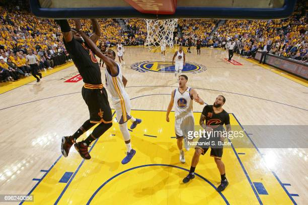 LeBron James of the Cleveland Cavaliers dunks the ball while guarded by Kevin Durant of the Golden State Warriors in Game Five of the 2017 NBA Finals...