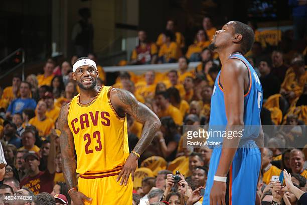LeBron James of the Cleveland Cavaliers faces off against Kevin Durant of the Oklahoma City Thunder on January 25 2015 at Quicken Loans Arena in...