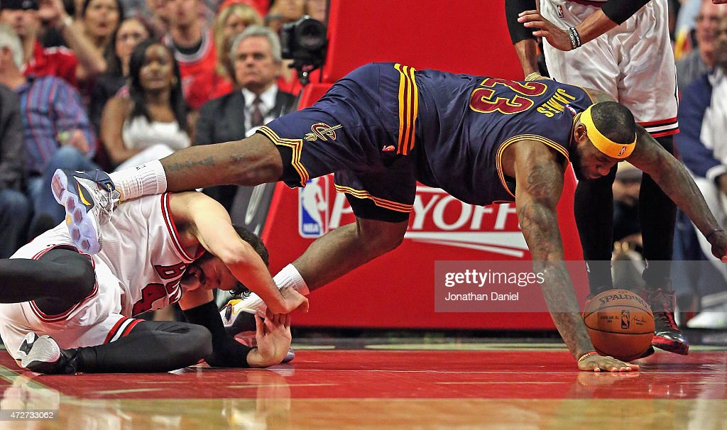 LeBron James #23 of the Cleveland Cavaliers falls over Nikola Mirotic #44 of the Chicago Bulls in Game Three of the Eastern Conference Semifinals of the 2015 NBA Playoffs at the United Center on May 8, 2015 in Chicago, Illinois. The Bulls defeated the Cavaliers 99-96.
