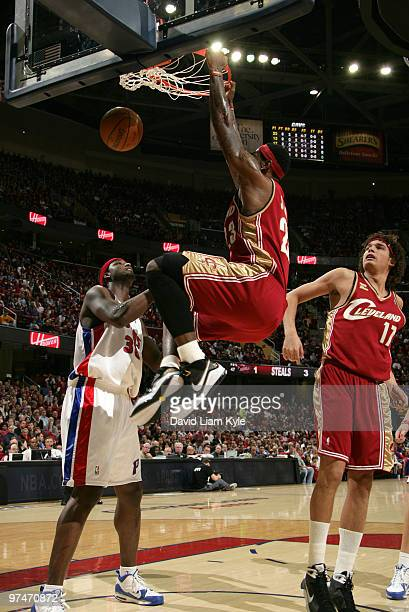 LeBron James of the Cleveland Cavaliers finishes off a dunk over Kwame Brown of the Detroit Pistons on March 5 2010 at The Quicken Loans Arena in...