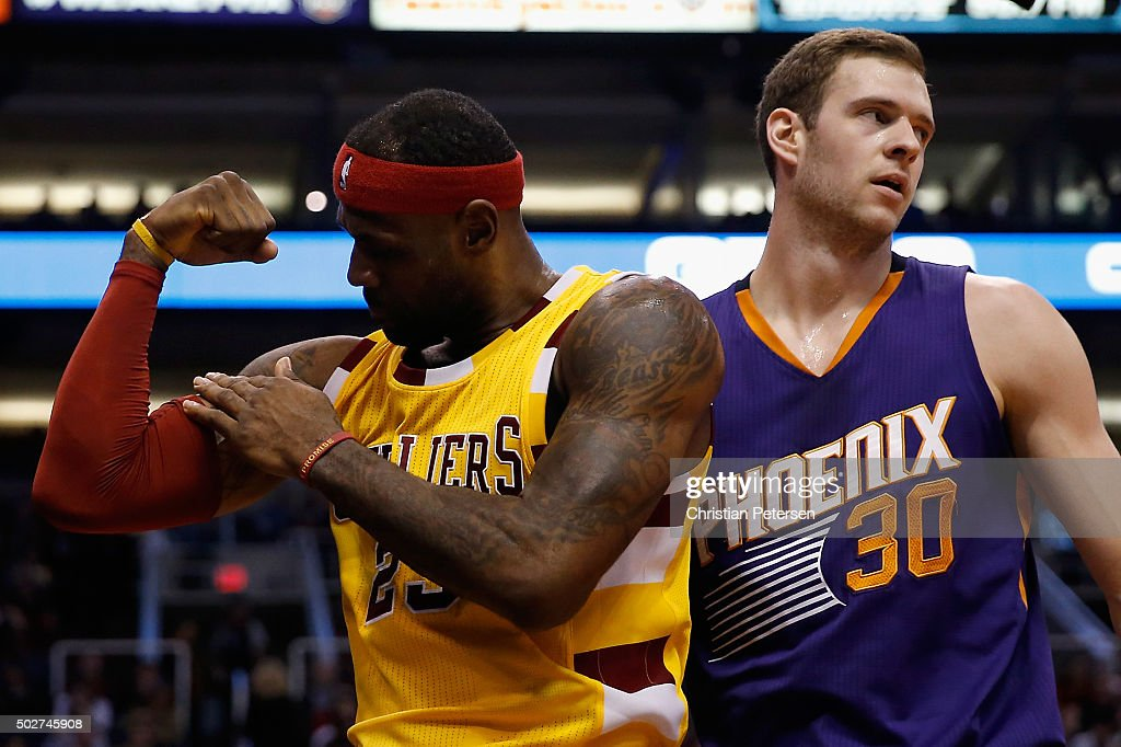 LeBron James of the Cleveland Cavaliers flexes after scoring and drawing a foul past Jon Leuer of the Phoenix Suns during the first half of the NBA...