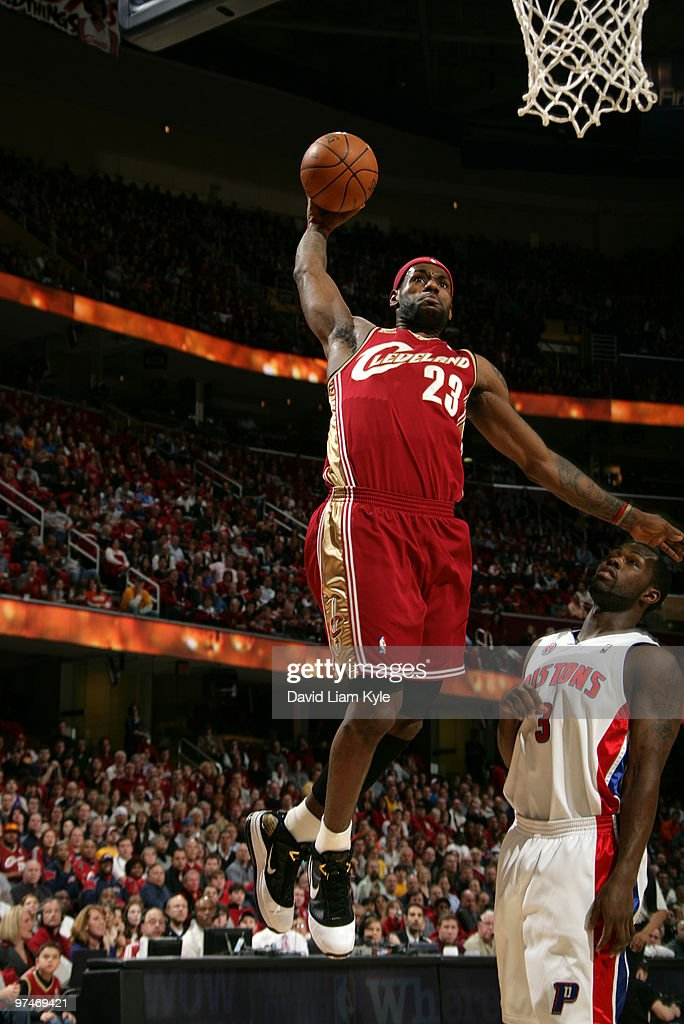 LeBron James of the Cleveland Cavaliers flies in for the dunk against Rodney Stuckey of the Detroit Pistons on March 5 2010 at The Quicken Loans...