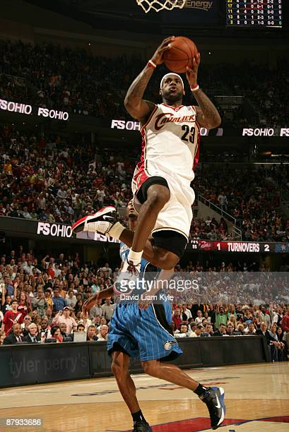 LeBron James of the Cleveland Cavaliers flies in for the shot defended by Rashard Lewis of the Orlando Magic in Game Two of the Eastern Conference...