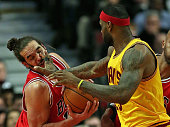LeBron James of the Cleveland Cavaliers fouls Joakim Noah of the Chicago Bulls at the United Center on February 12 2015 in Chicago Illinois The Bulls...