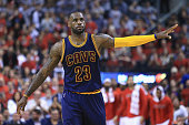 LeBron James of the Cleveland Cavaliers gestures during the first half against the Toronto Raptors in game three of the Eastern Conference Finals...