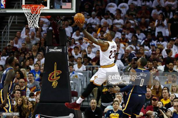 LeBron James of the Cleveland Cavaliers gets to the basket past CJ Miles of the Indiana Pacers during the first half in Game One of the Eastern...