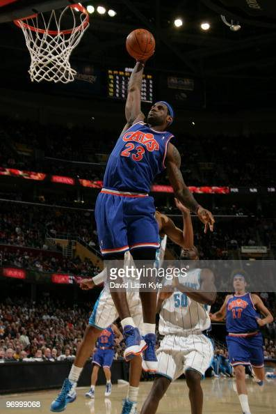 LeBron James of the Cleveland Cavaliers glides in for the dunk followed by Emeka Okafor of the New Orleans Hornets on February 23 2010 at The Quicken...