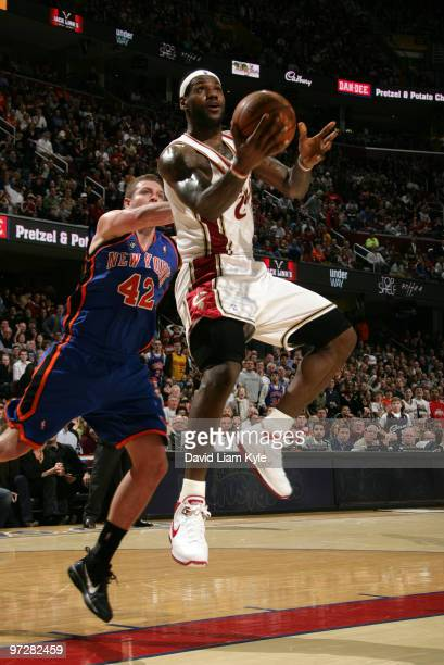 LeBron James of the Cleveland Cavaliers glides in for the layup trailed by David Lee of the New York Knicks on March 1 2010 at The Quicken Loans...