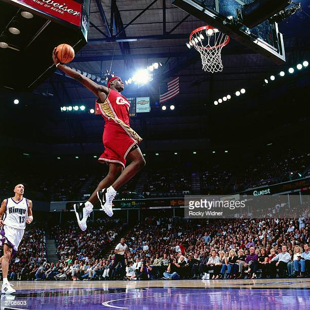 LeBron James of the Cleveland Cavaliers goes for a dunk against the Sacramento Kings during the NBA game at the Arco Arena on October 29 2003 in...