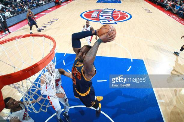 LeBron James of the Cleveland Cavaliers goes for a dunk during the game against the Detroit Pistons on March 9 2017 at The Palace of Auburn Hills in...