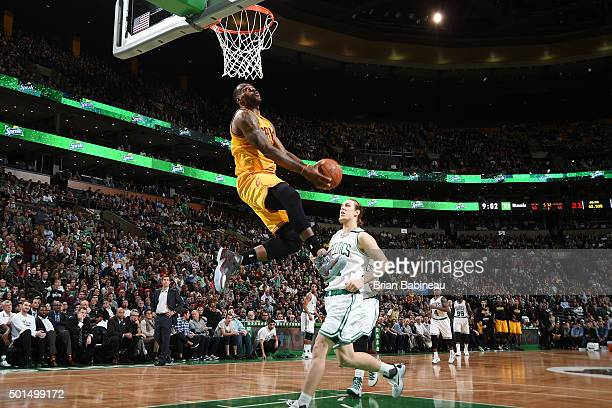 LeBron James of the Cleveland Cavaliers goes for the dunk against the Boston Celtics during the game on December 15 2015 at TD Garden in Boston...