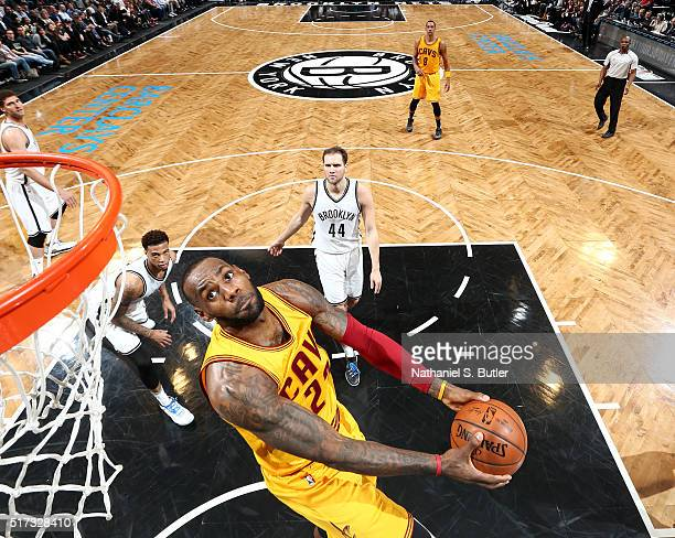 LeBron James of the Cleveland Cavaliers goes for the dunk against the Brooklyn Nets during the game on March 24 2016 at Barclays Center in Brooklyn...