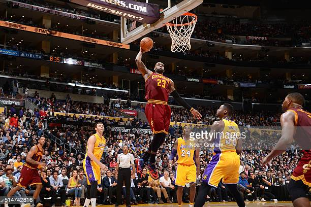 LeBron James of the Cleveland Cavaliers goes for the dunk during the game against the Los Angeles Lakers on March 10 2016 at STAPLES Center in Los...