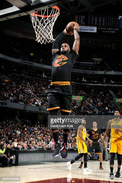 LeBron James of the Cleveland Cavaliers goes for the dunk during the game against the Indiana Pacers on February 15 2017 at Quicken Loans Arena in...