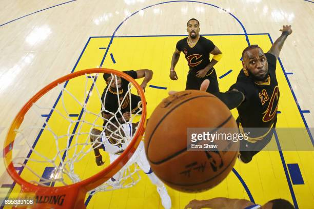 LeBron James of the Cleveland Cavaliers goes for the rebound against the Golden State Warriors during the first quarter in Game 5 of the 2017 NBA...