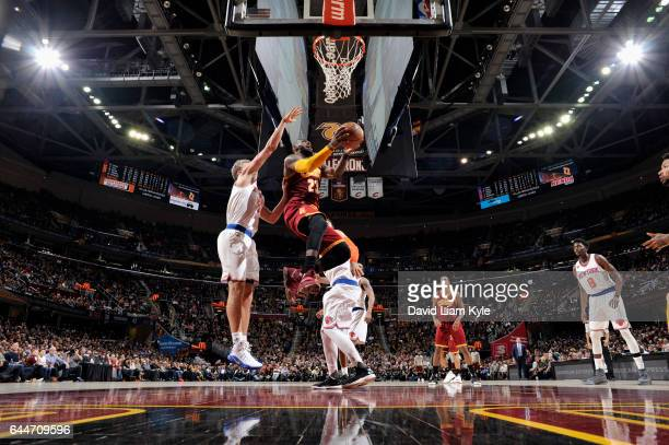 LeBron James of the Cleveland Cavaliers goes to the basket against the New York Knicks on February 23 2017 at Quicken Loans Arena in Cleveland Ohio...