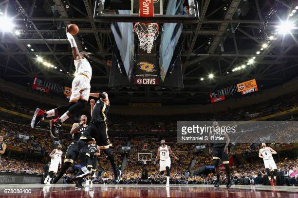 LeBron James of the Cleveland Cavaliers goes to the basket against the Toronto Raptors during Game Two of the Eastern Conference Semifinals of the...