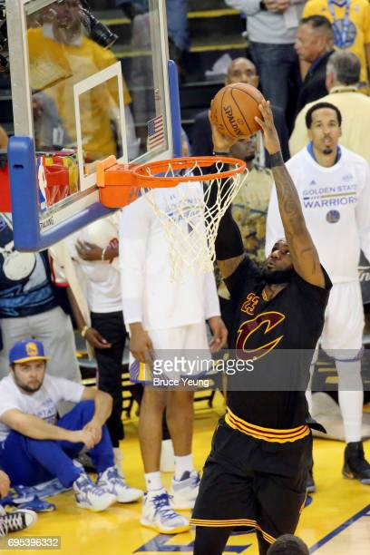LeBron James of the Cleveland Cavaliers goes to the basket against the Golden State Warriors in Game Five of the 2017 NBA Finals on June 12 2017 at...