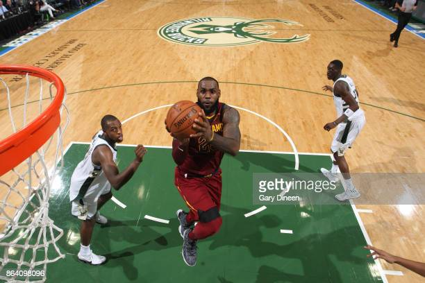 LeBron James of the Cleveland Cavaliers goes to the basket against the Milwaukee Bucks on October 20 2017 at the BMO Harris Bradley Center in...
