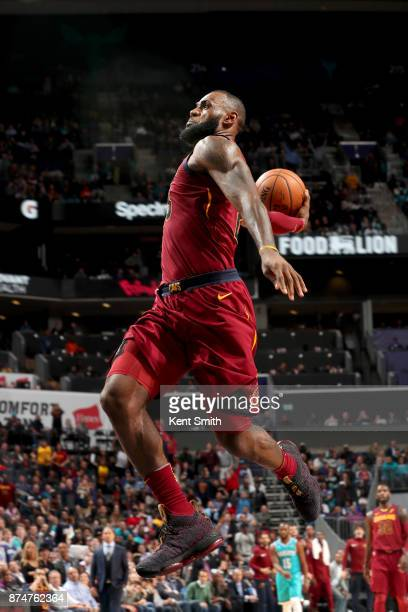 LeBron James of the Cleveland Cavaliers goes to the basket against the Charlotte Hornets on November 15 2017 at Spectrum Center in Charlotte North...