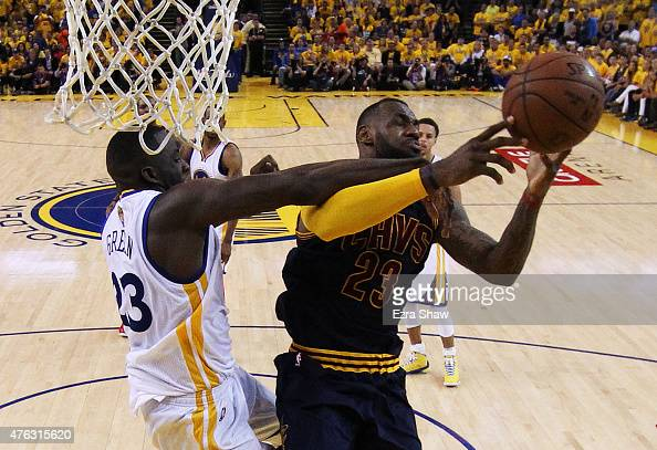 LeBron James of the Cleveland Cavaliers goes up against Draymond Green of the Golden State Warriors in the second half during Game Two of the 2015...