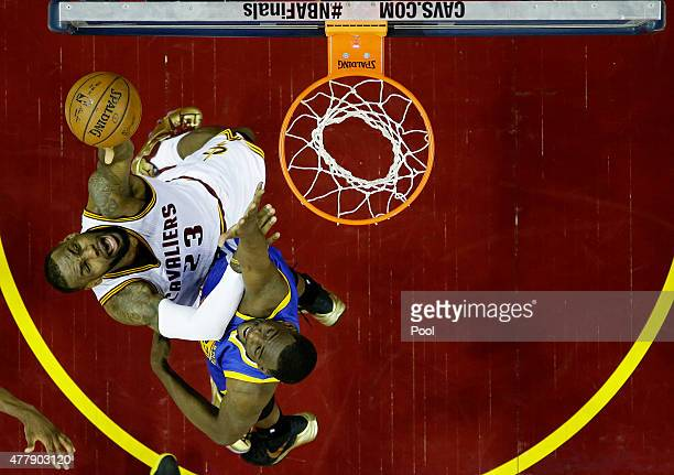 LeBron James of the Cleveland Cavaliers goes up against Draymond Green of the Golden State Warriors during Game Six of the 2015 NBA Finals at Quicken...