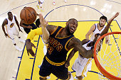 LeBron James of the Cleveland Cavaliers goes up against Klay Thompson of the Golden State Warriors in the first half during Game One of the 2015 NBA...