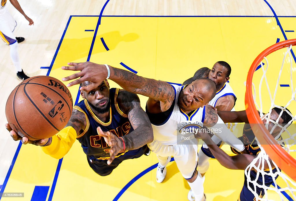 LeBron James of the Cleveland Cavaliers goes up against Marreese Speights of the Golden State Warriors in the first half during Game Two of the 2015...