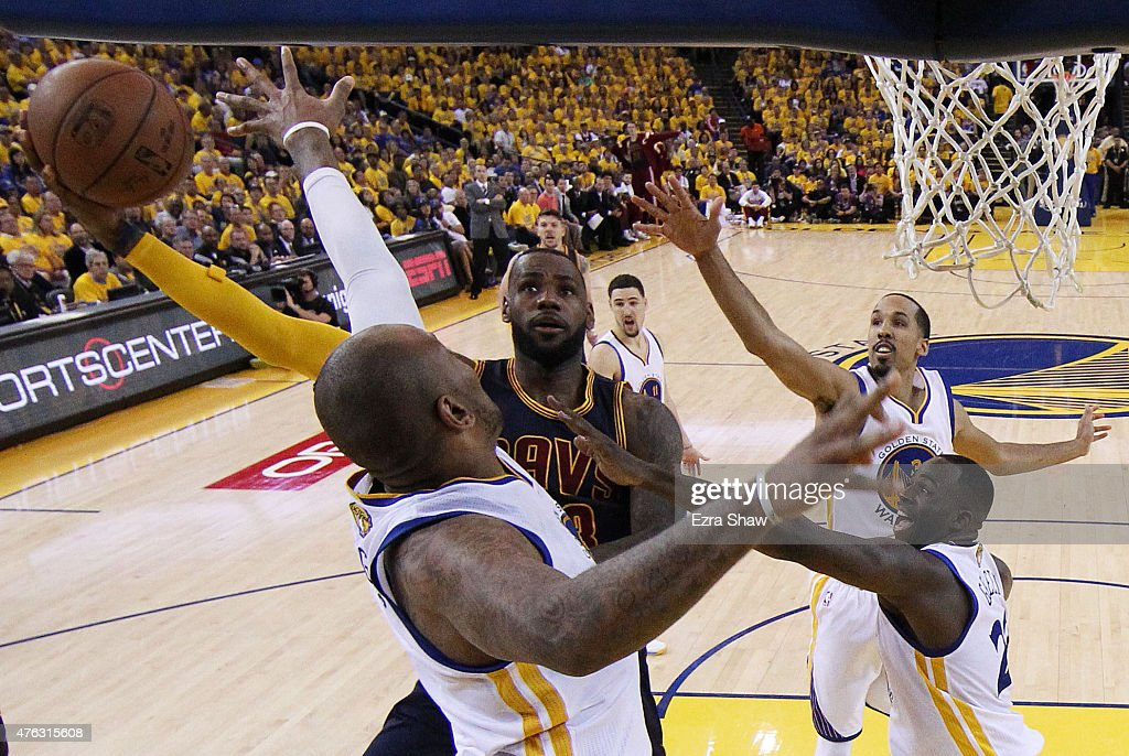 LeBron James of the Cleveland Cavaliers goes up against Marreese Speights of the Golden State Warriors in the second half during Game Two of the 2015...