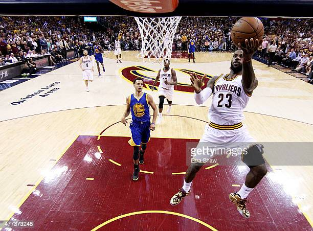 LeBron James of the Cleveland Cavaliers goes up against Stephen Curry of the Golden State Warriors in the first half during Game Six of the 2015 NBA...
