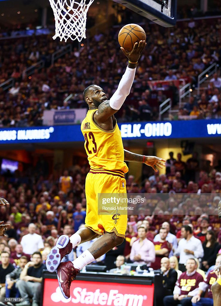 LeBron James of the Cleveland Cavaliers goes up against the Golden State Warriors in the third quarter during Game Four of the 2015 NBA Finals at...