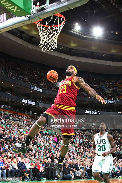 LeBron James of the Cleveland Cavaliers goes up for a dunk against the Boston Celtics on November 14 2014 at the TD Garden in Boston Massachusetts...