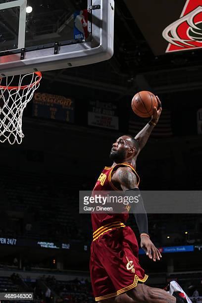 LeBron James of the Cleveland Cavaliers goes up for a dunk against the Milwaukee Bucks on April 8 2015 at BMO Harris Bradley Center in Milwaukee...